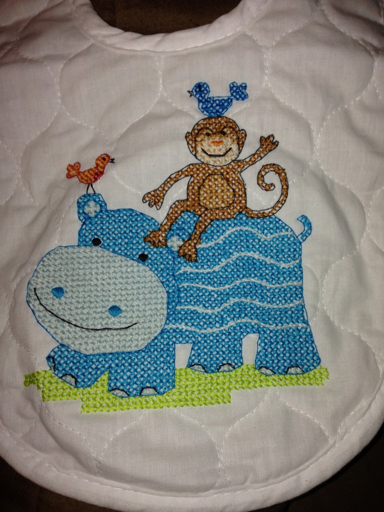 Finished cross stitch hippo bib